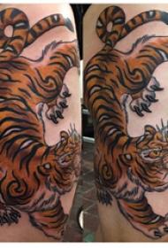 纹身大腿男 男生大腿上彩色的老虎纹身图片