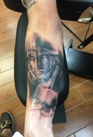 歐美小腿紋身 男生小腿上黑色的武士紋身圖片
