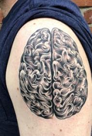 纹身黑色 男生大臂上黑色的大脑纹身图片
