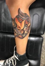 般若面具纹身 男生小腿上彩色的般若纹身图片