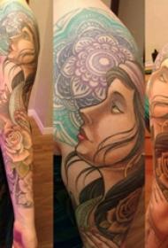 人物纹身图案 女生的手臂上人物纹身图案