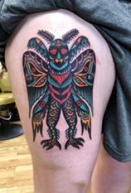 大腿纹身传统 女生大腿上彩色的怪物纹身图片