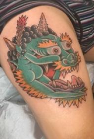 纹身龙头  女生手臂上彩色的龙头纹身图片