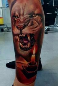 狮子王纹身  男生小腿上彩色的狮子纹身图片