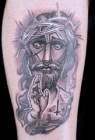 欧美小腿纹身 男生小腿上黑灰的耶稣纹身图片