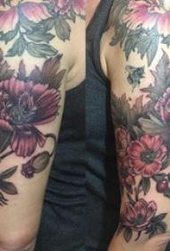 罂粟纹身  女生大臂上彩绘的罂粟纹身图片