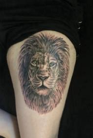 狮子头纹身图片 男生大腿上黑色的狮子纹身图片