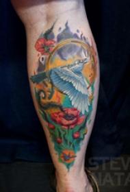 罂粟花纹身图片  男生小腿上罂粟花和鸟纹身图片
