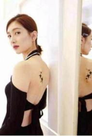 江疏影纹身图  明星后背上黑色的星星纹身图片