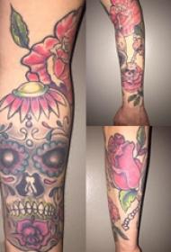 骷髅和花朵纹身图案  女生手臂上创意骷髅和花朵纹身图片