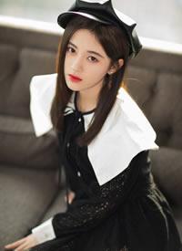 鞠婧祎身穿黑色连衣裙带小皮帽可爱图片