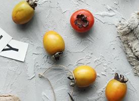 一组椭圆型的柿子唯美拍摄图片欣赏