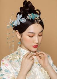 稳严重年夜气的中式,娇媚可儿的旗袍,将西方新娘的婉约展示无遗