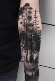 小臂上暗黑色的树木森林纹身图片