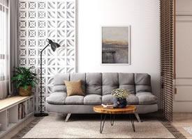 白净的墙面,温润的木质地板,烟灰色的沙发