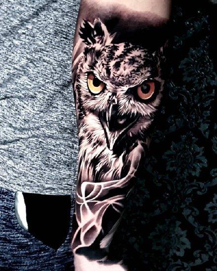 点击大图看下一张:一组黑灰写实手臂纹身图案