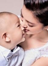 李冰冰妹妹李雪携儿子登封面 大显母爱