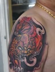 大臂彩色貔貅纹身图片
