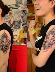 手臂上好看的象神纹身