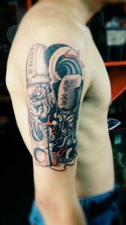 手臂恐怖的黑白无常纹身