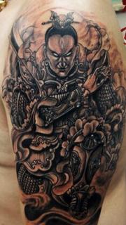 個性帥氣的二郎神手臂刺青